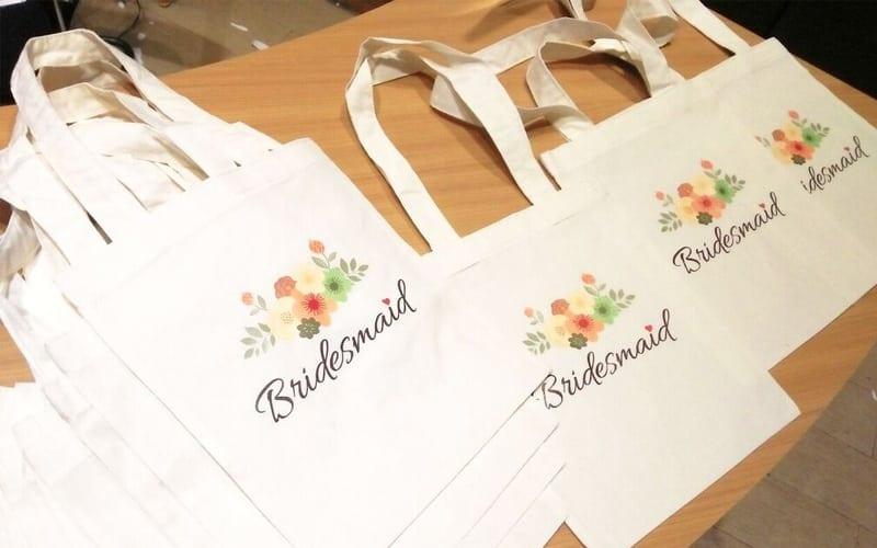 tote bag custom dengan gamber bunga dan tulisan bridgesmail